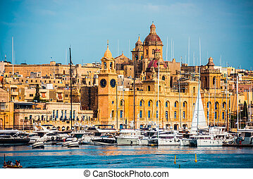 view on Birgu and the harbour with boats