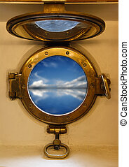 view on blue sea through nautical porthole