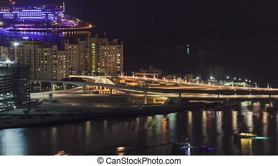 View on bridge of artificial island Palm Jumeirah in Dubai at night timelapse
