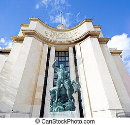 view on bronze statue at the trocadero square in paris