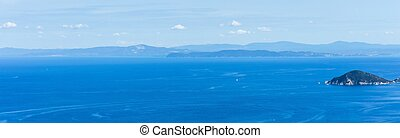 View on coastline of Tuscany in Italy from Elba island