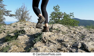 View on Feet of Traveler Woman Hiking Walking on the Top of...