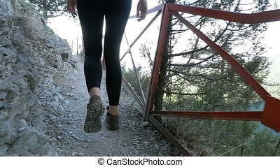View on Feet of Traveler Woman Hiking Walking on Trail Path...