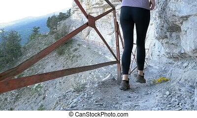 View on Feet of Traveler Woman Hiking Walking on Trail Path in Stone Mountain. Slow Motion