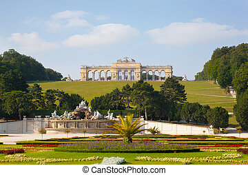 View on Gloriette structure and Neptune fountain in Schonbrunn Palace, Vienna, Austria