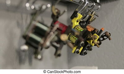 View on Induction tattoo machines on stand, running focus, ...