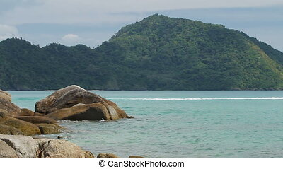 View on Laem Ka beach on Phuket island, Thailand. Peaceful seascape and hill on background.