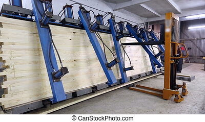 View on machine adheres and presses wooden bars - View on...