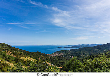 View on Marciana marina from the hill over the bush and forest
