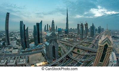View on modern skyscrapers and busy evening highways day to night timelapse in luxury Dubai city, Dubai, United Arab Emirates