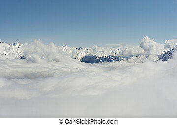View on mountains and blue sky above clouds, Krasnaya Polyana, Sochi, Russia