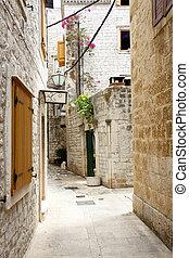 View on narrow alley - Trogir, Croatia.