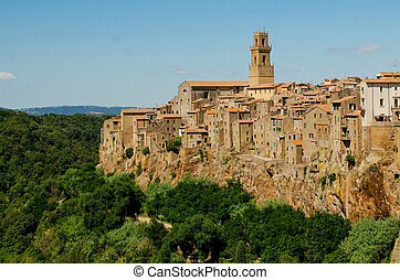 View on old town of Pitigliano and forest around, Italy