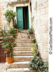 View on open green door - Trogir