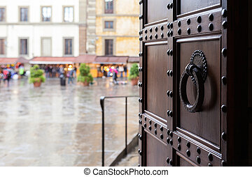 view on piazza in Florence city in rain