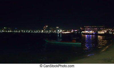View on sea shore at night. Sea surf near embankment. Pattaya, Thailand.