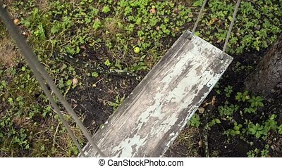 garden swing from above - view on shaking vintage garden...