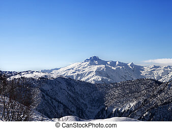 View on snowy mountains and blue sky in sunny morning