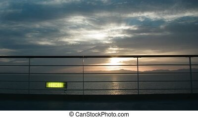 View on sunset on sea from ship deck