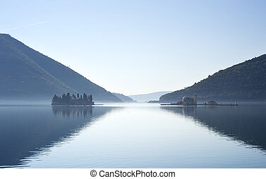 """View on Sv.Djordje (left) and Gospa od Skrpjela ( right) alo known as Church """"Our Lady of the rocks"""" in the morning. Perast, Montenegro"""