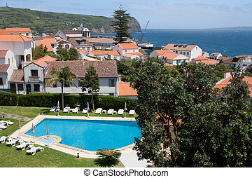 view on swimming pool, houses and ocean in Azores