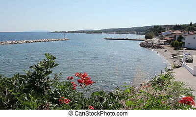 View on the bay with artificial reef, walled seashore...