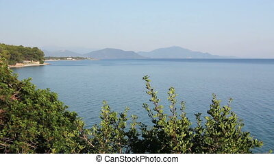 View on the bay with green vegetation and blue sea water -...