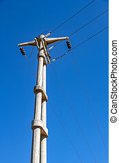 View on the electric wires on the pole on a sunny day.