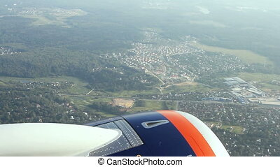 View on the engine of airplane from window - MOSCOW, Russian...