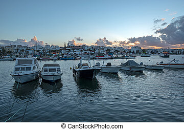View on the harbor from Lagos in the Algarve Portugal at sunset