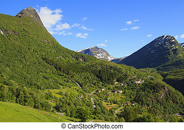 View on the mountain road and village in Geiranger. Norway