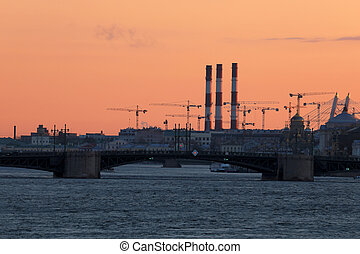 View on the Palace Bridge in the rays of sunset between Palace Square and Vasilievsky Island in St. Petersburg, Russia.