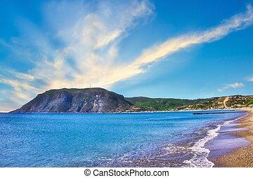 View on the rock from the Agios Stefanos Bay beach on Kos island
