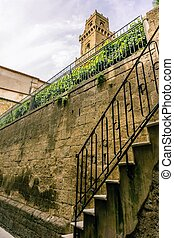 View on the tower in Pitigliano over the tuf wall and stairs