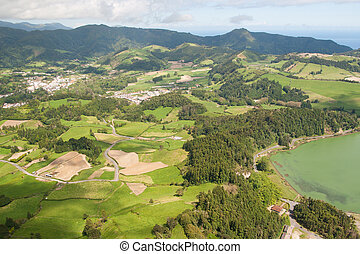 view on village in mountains and lake in Azores