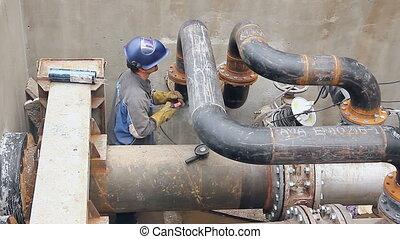 View on welder until welding pipeline junction - Welder is...