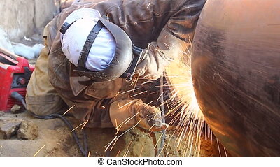 View on welder until welding pipeline - Welder is in trench...