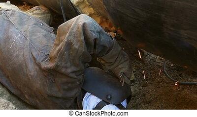 View on welder until welding pipeline - Welder is in trench...