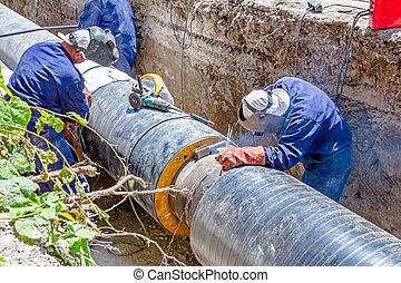 View on welding team of welders until them assembly a new pipeline
