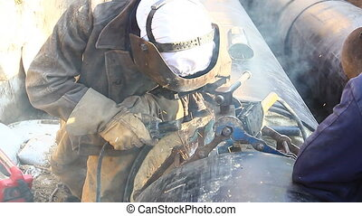 View on welding team of welders until them assembly a new pipeline.