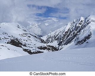 View on winter mountain landscape at Stubai Gletscher ski area with snow covered peaks at spring sunny day. Blue sky background. Stubaital, Tyrol, Austrian Alps