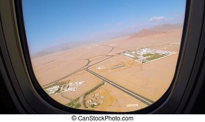 View out an airplane window. Airplane flies between of...
