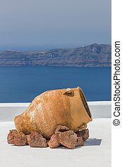 View out to sea over the white walls of Santorini