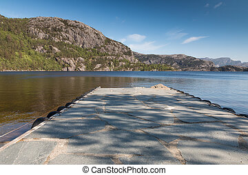 View over a dock at Revsvatnet lake, close to Preikestolen, Norway