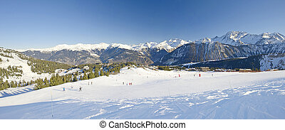 View over a ski resort - Panoramic view over a piste at ski...