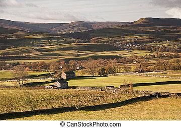 View over Askrigg towards Pen-y-Ghent in Yorkshire Dales...
