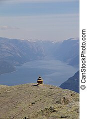 View over beautiful Lysefjord, Norway, with a stone sculpture in the foreground
