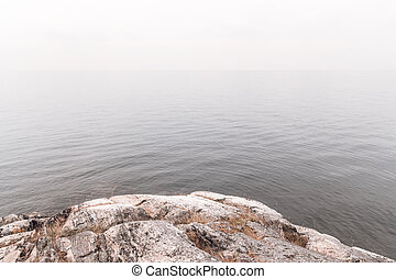 View over calm misty water