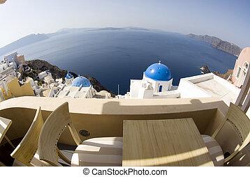view over greek island churches - fish-eye bird\\\'s eye...