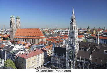 City house of Munich at the Marienplatz and the church of our lady